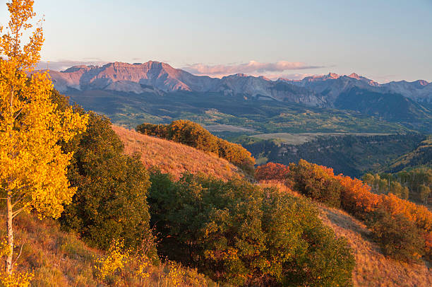 Autumn Sunset Over Telluride Colorado Fall sunset over the town of Telluride, Colorado. Taken from an overlook along Last Dollar Road. san juan mountains stock pictures, royalty-free photos & images