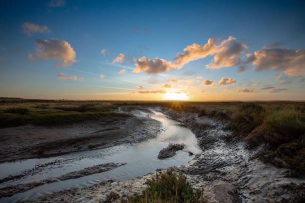 Autumn sunset over the popular Norfolk coast marshes stock photo