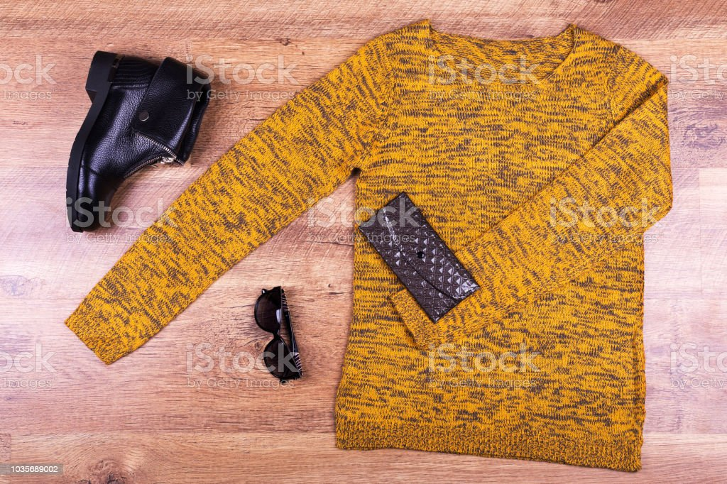 Autumn sweater, boots, purse and glasses stock photo