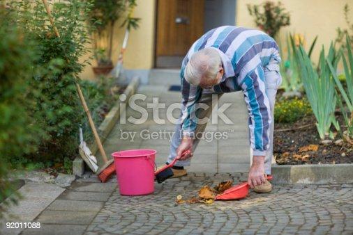 istock Autumn sweeping 92011088