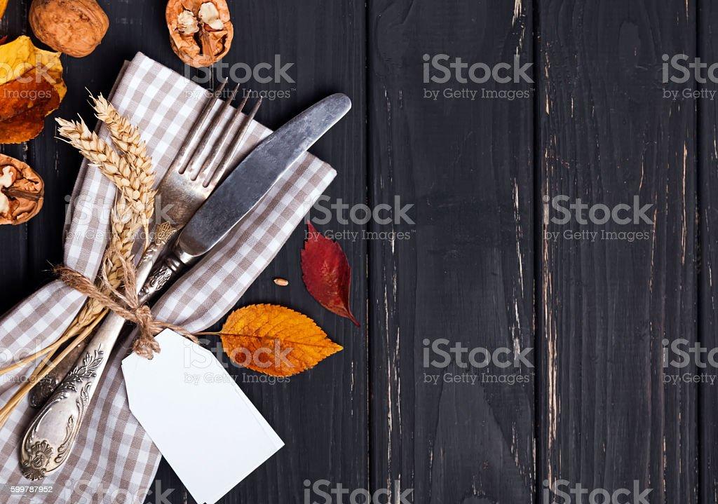 Autumn table setting on black wooden background stock photo
