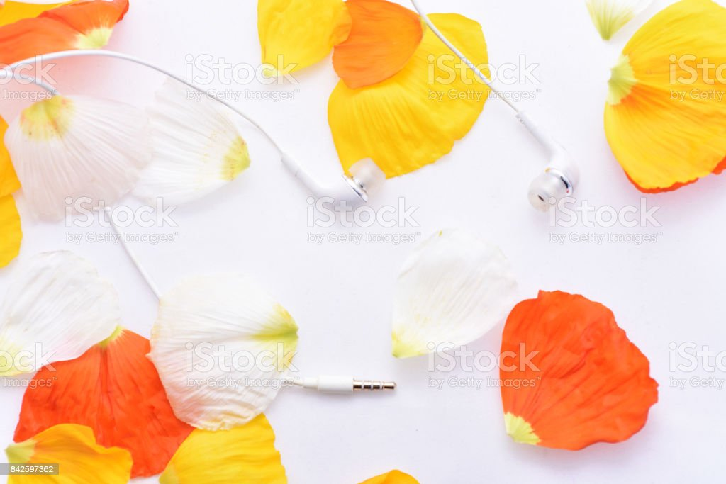 Autumn texture with white headphones stock photo