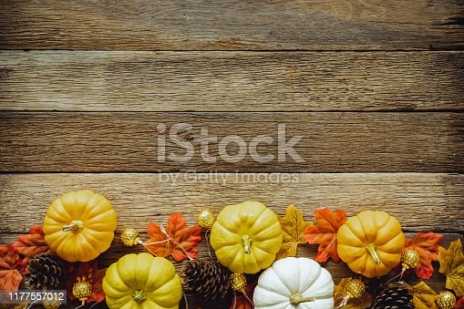 Autumn Thanksgiving day background from maple leaves on table wood vintage tone with red, orange, yellow and brown