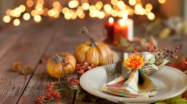 autumn thanksgiving dining table place setting on an old wood rustic table - thanksgiving стоковые фото и изображения