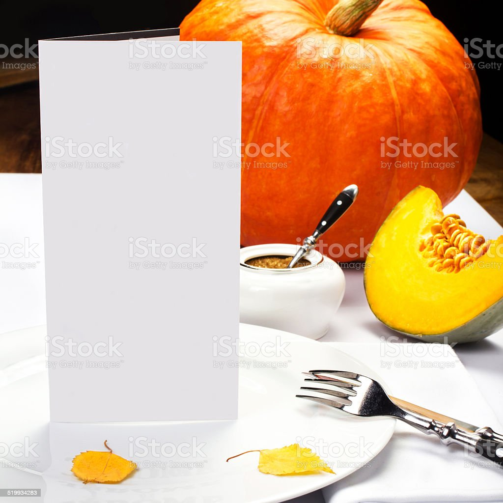 Autumn Thanksgiving dinner table setting with pumpkins and blank stock photo