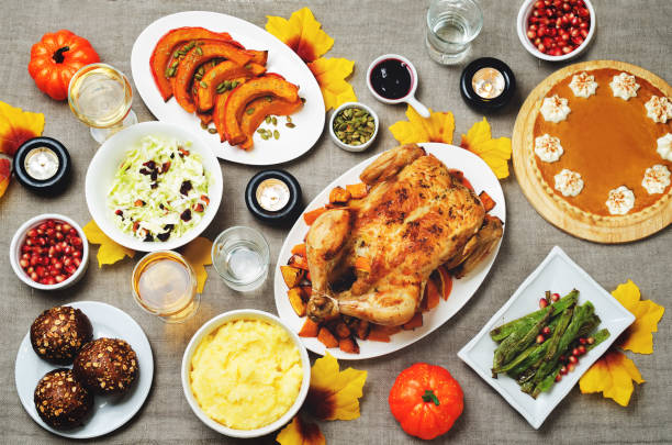 autumn thanksgiving main dish table setting - pumpkin pie стоковые фото и изображения