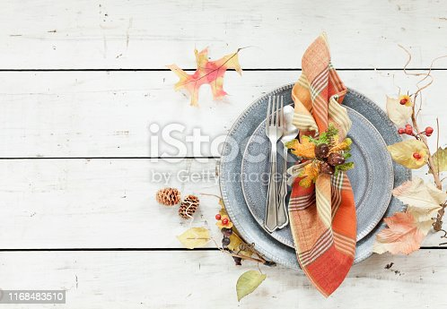 Autumn holiday Thanksgiving dining place setting on an old wood table