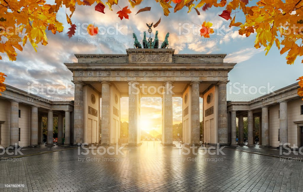 Autumn time in Berlin: the historical Brandeburger Tor Gate during sunset time stock photo
