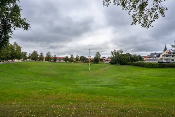 Autumn town landscape view of the large grassy pit Gropen on a green field in Leksand Sweden. stock photo
