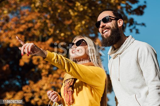 istock autumn travel couple enjoying fall landscape 1159292302