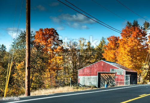 Bethel, Maine, Usa - October 10, 2016:  Wild wooden storage house in Maine along the road to Bethel (Maine) . Sunny day.