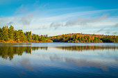 istock Autumn Trees On a Clear Lake 524259435
