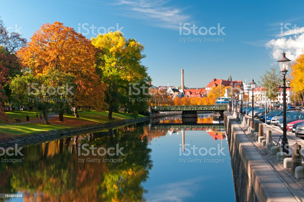 Autumn trees reflecting on river in Rosenlundskanalen stock photo