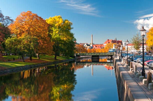 Autumn trees reflecting on river in Rosenlundskanalen stock photo