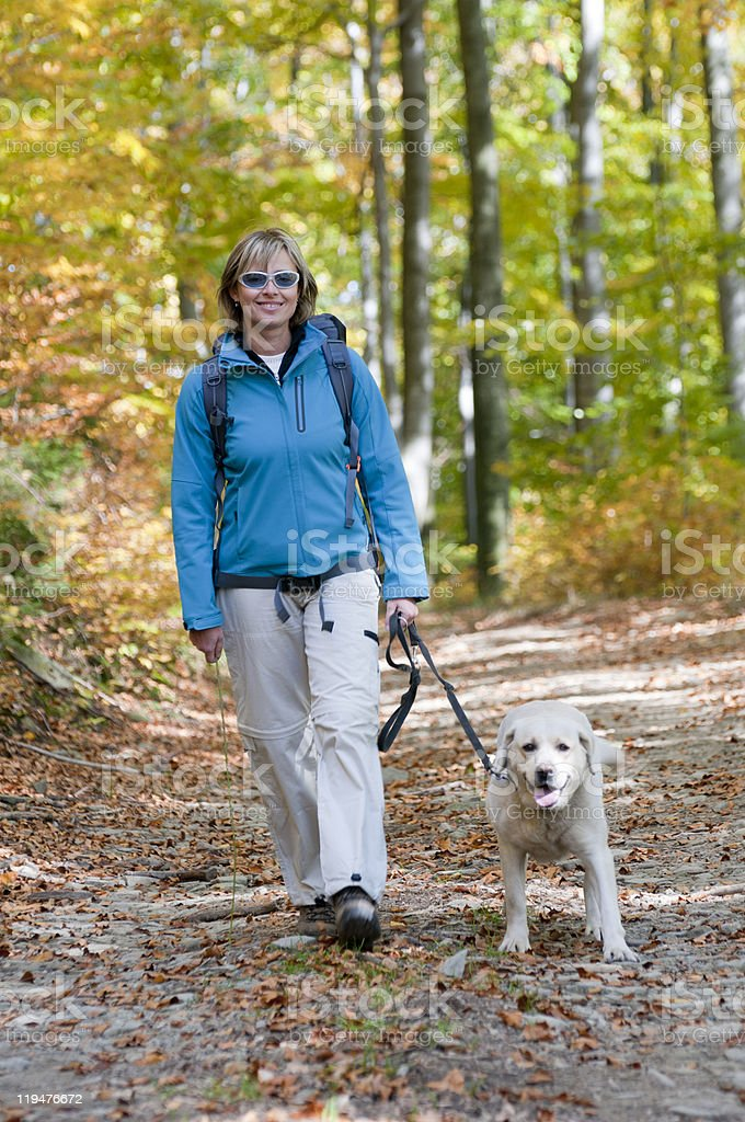 Autumn trekking with dog royalty-free stock photo