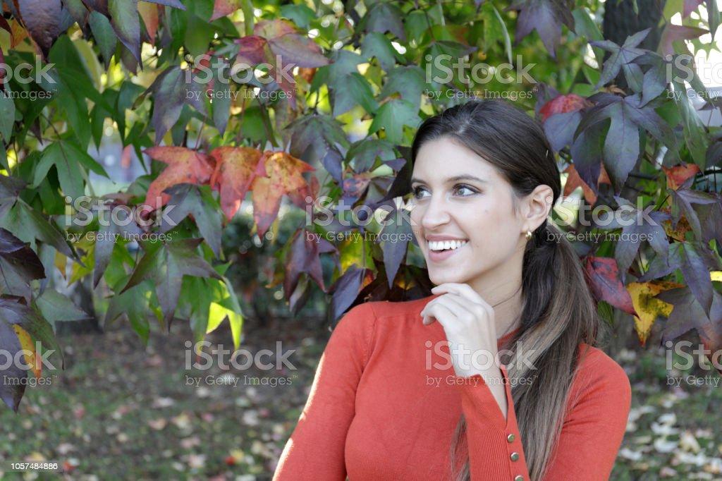 Autumn uranium orange for smiling Russian outdoor girl stock photo