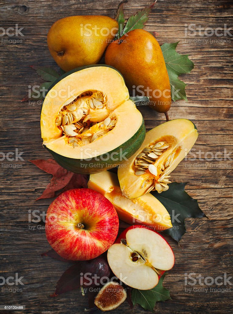Autumn vegetables and fruits on wooden background. stock photo