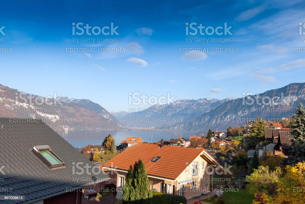 Autumn view of Lake Thun and typical Switzerland village near town of Interlaken, canton of Bern stock photo