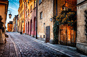 istock Autumn view of the birch street in the morning in Warsaw's Old Town, Poland 1045577600
