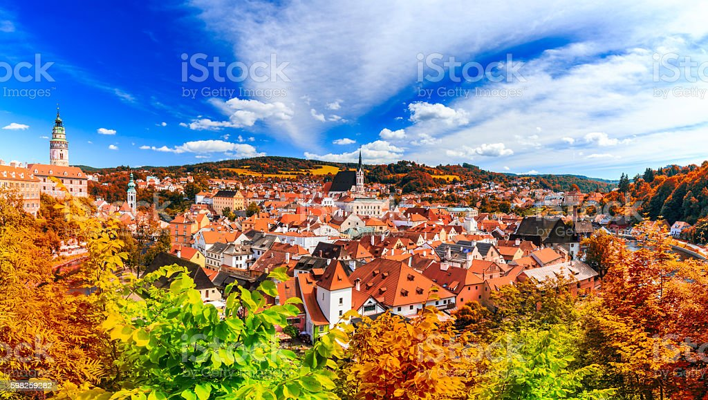 Autumn view with red foliage on the Cesky Krumlov stock photo