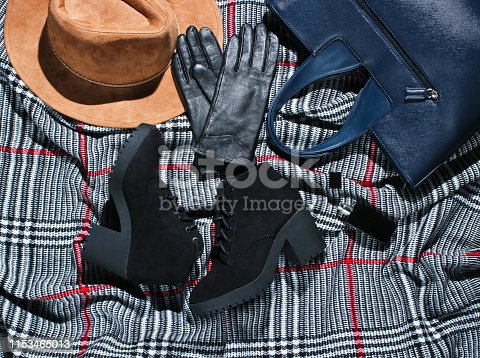 840310962istockphoto Autumn wardrobe. Women's things, shoes and accessories. Felt hat, suede shoes, leather gloves, a bottle of perfume on scarf. Flat lay 1153465013