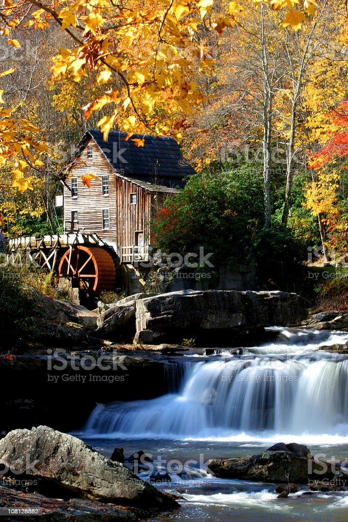 Autumn Waterfall and Watermill with House stock photo