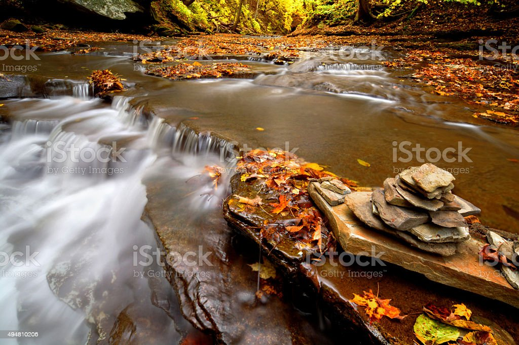 Autumn Waterfall Cairn stock photo