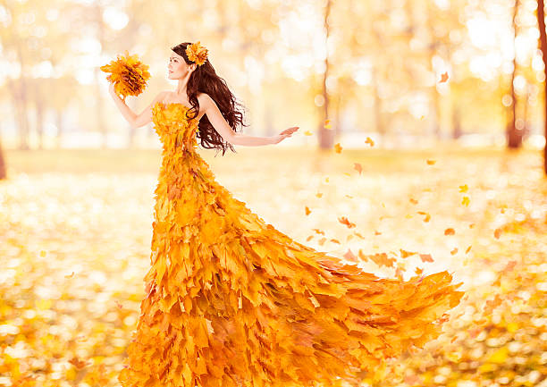 Autumn woman fashion dress of fall maple leaves, beauty portrait stock photo