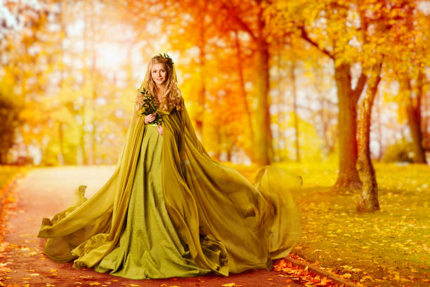 Autumn Woman, Fashion Model Outdoor Portrait, Girl in Autumnal Dress walking in Yellow Fall Leaves Park stock photo