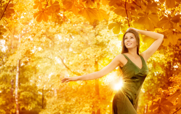 Autumn Woman, Happy Fashion Model in Yellow Forest, Beautiful Girl on Fall Leaves stock photo