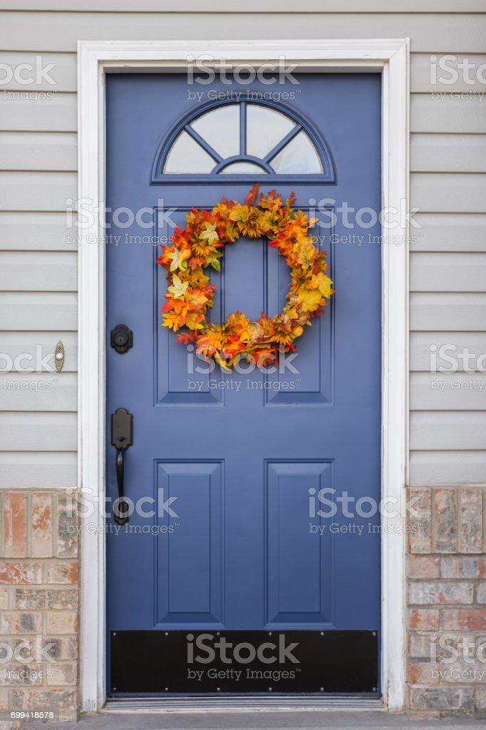 Autumn wreath on home front door stock photo