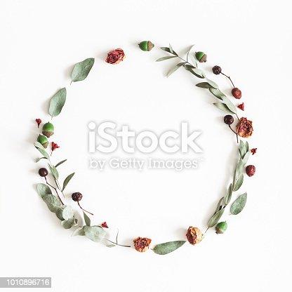 istock Autumn wreath on white background. Flat lay, top view 1010896716