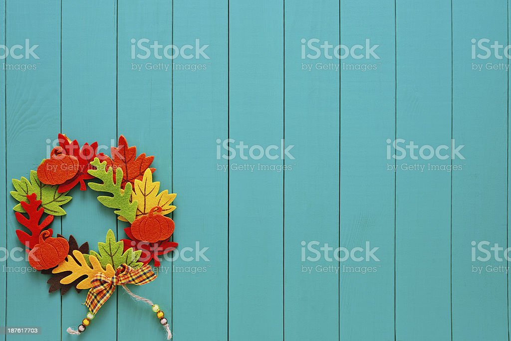 Autumn wreath with a pump copy space on turquoise woods royalty-free stock photo