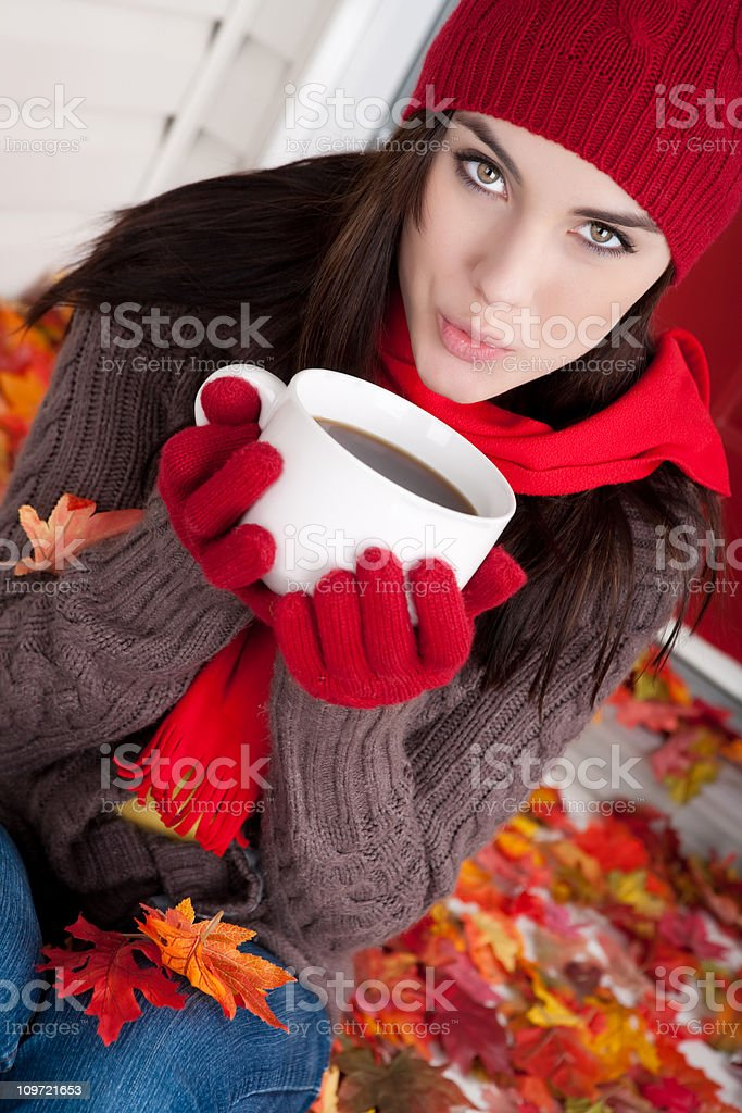 Autumn: Young female holding coffee mug royalty-free stock photo