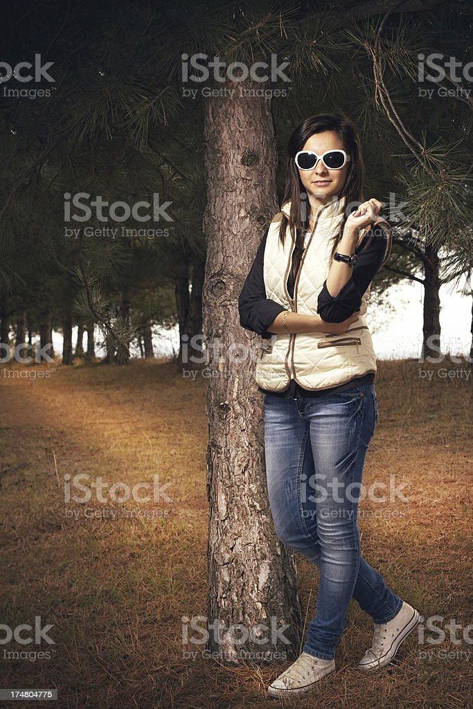 Autumn young girl in the park royalty-free stock photo