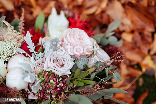 1129427811 istock photo autumnal bridal bouquet. bride holding wedding bouquet 1131697885