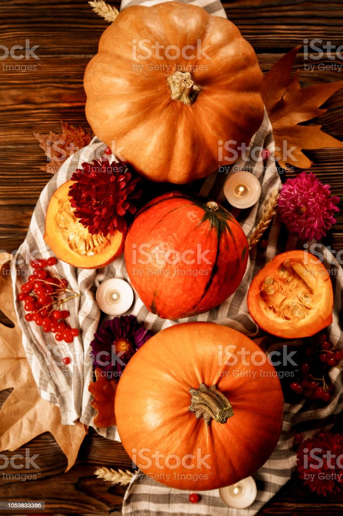 Thanksgiving background concept. Local produce pumpkin, apples &...