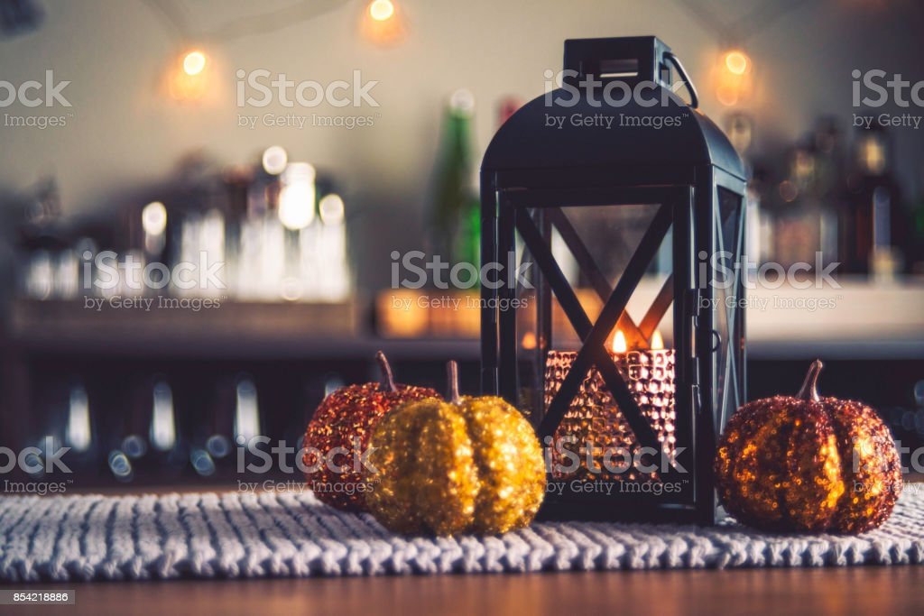 Autumnal decorations of lantern and pumpkins for fall holidays