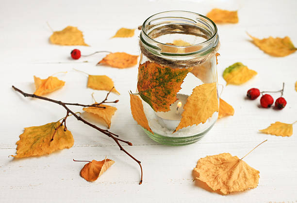 autumn-themed diy candle. - kandelaar stockfoto's en -beelden