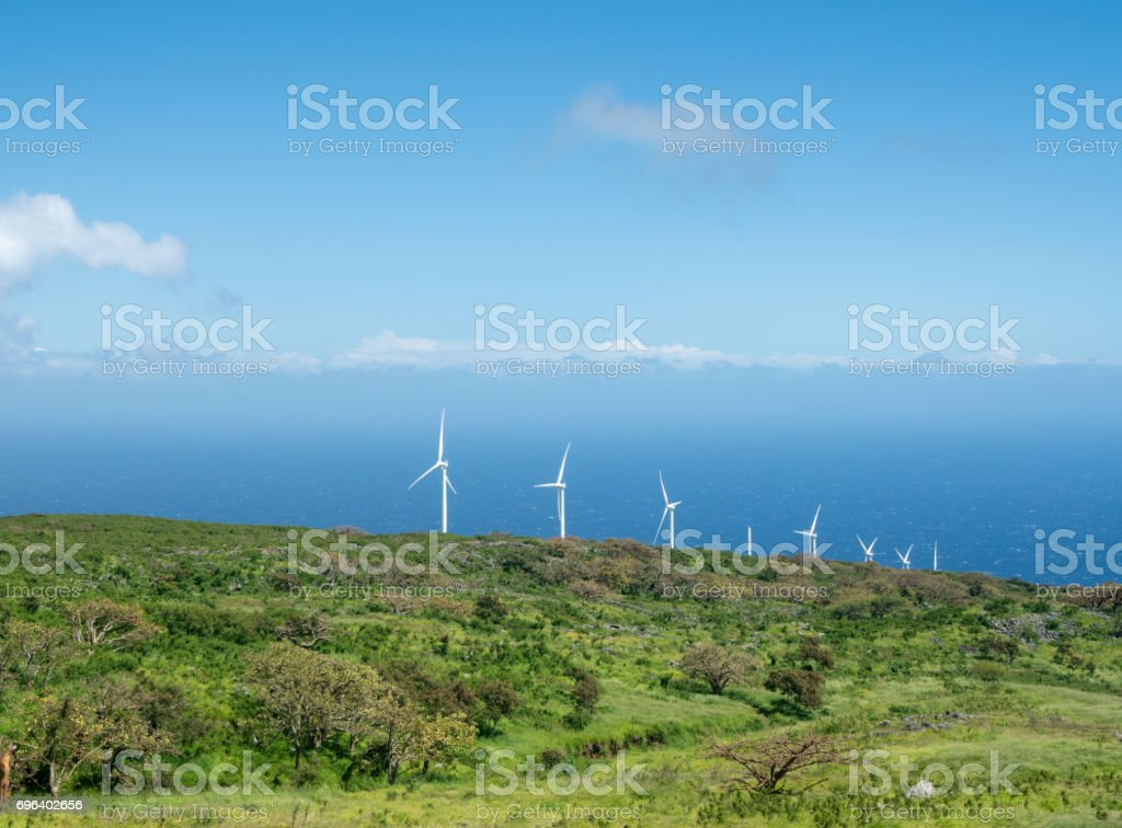 Auwahi wind turbines around the back side of Haleakala on Maui stock photo
