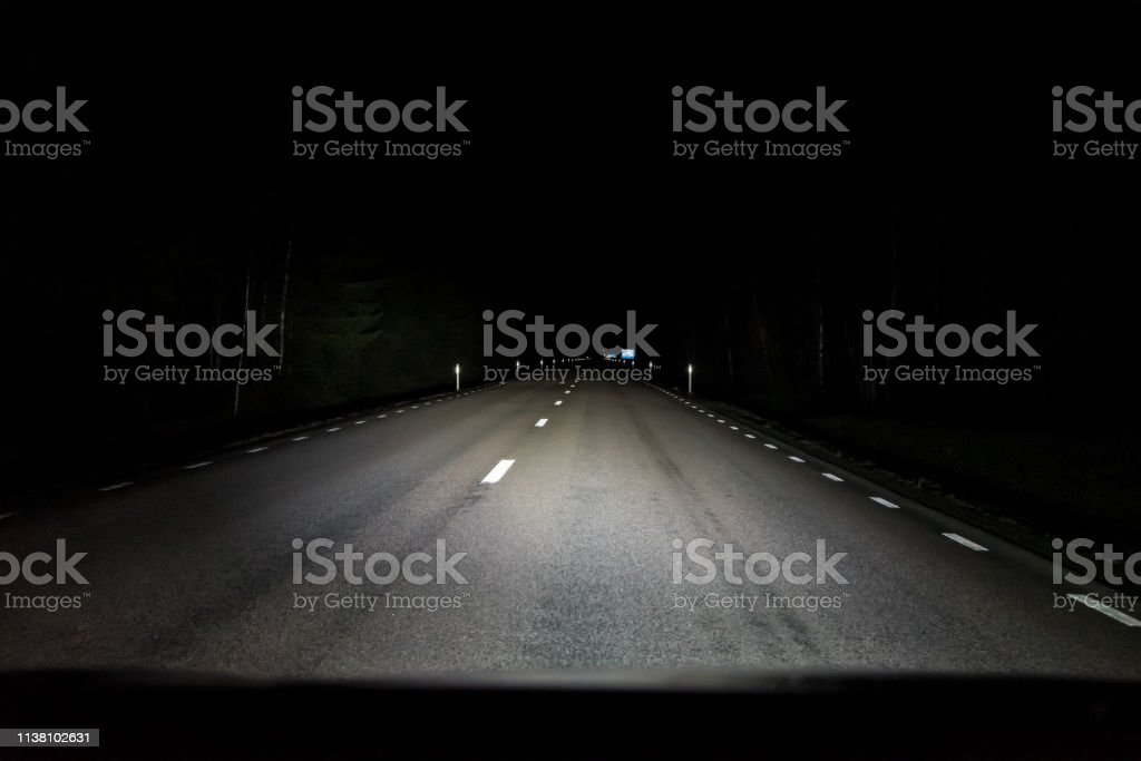auxiliary lamps lighting up the dark road in sweden at night