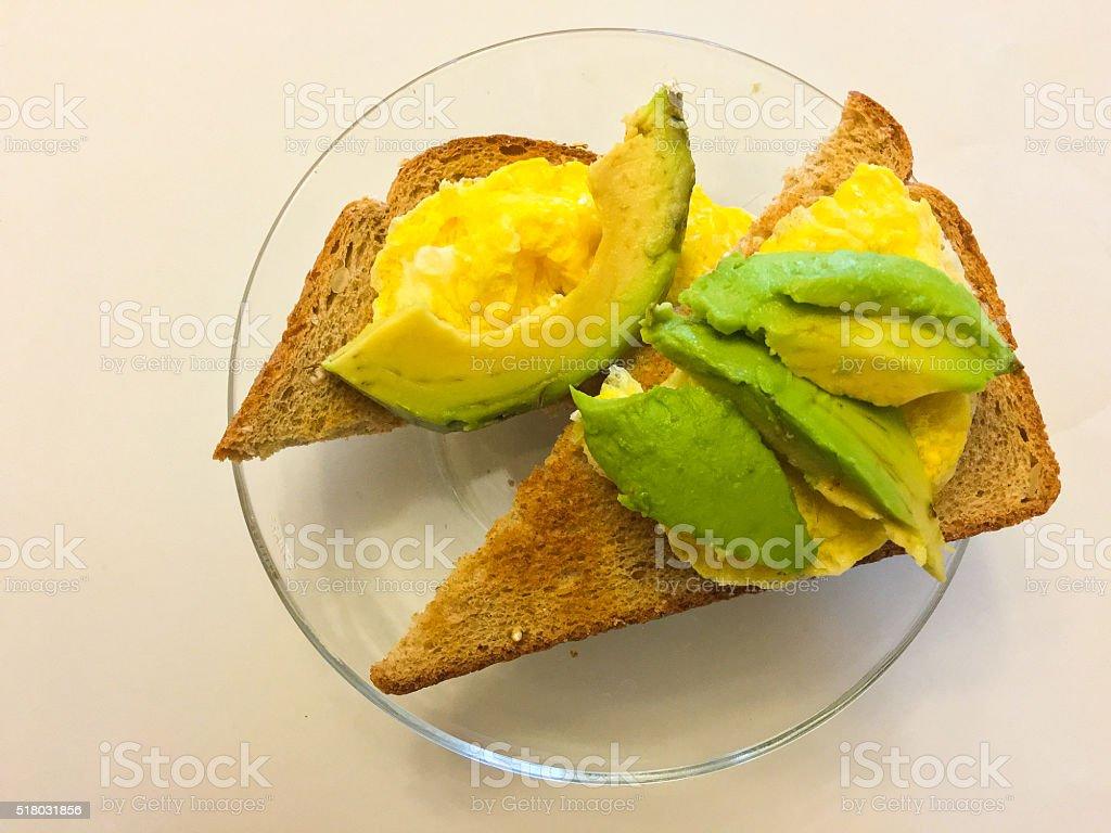 avacado and eggs on toast stock photo