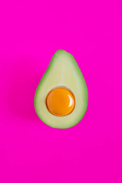 Avacado with egg yolk stock photo