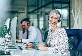 Smiling beautiful businesswoman working in call center