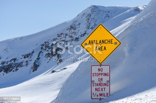 Avalanche Area Sign.  Road sign on high mountain pass.  Yellow colorful sign in english.  Loveland Pass, Colorado USA.  Captured as a 14-bit Raw file. Edited in ProPhoto RGB color space.
