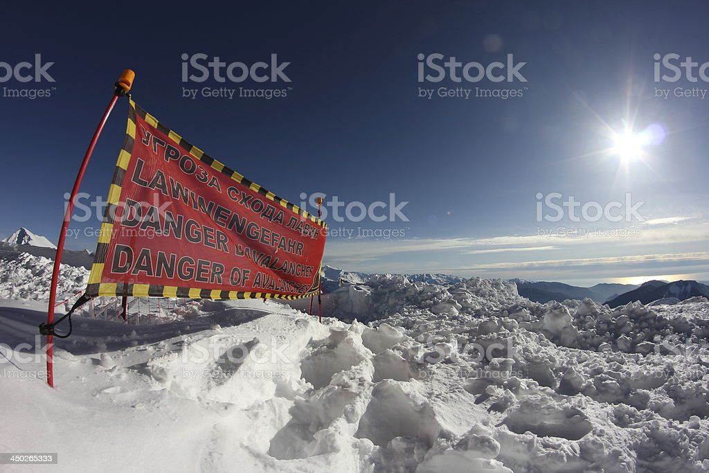 avalanche danger sign in snow stock photo