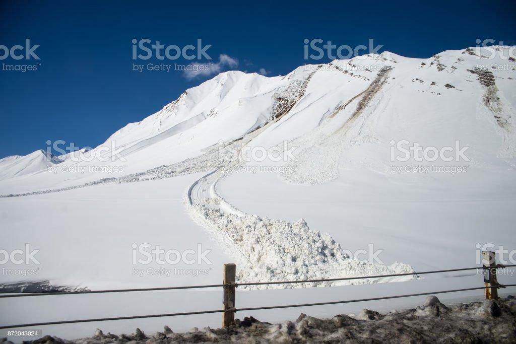 avalanche near the road stock photo
