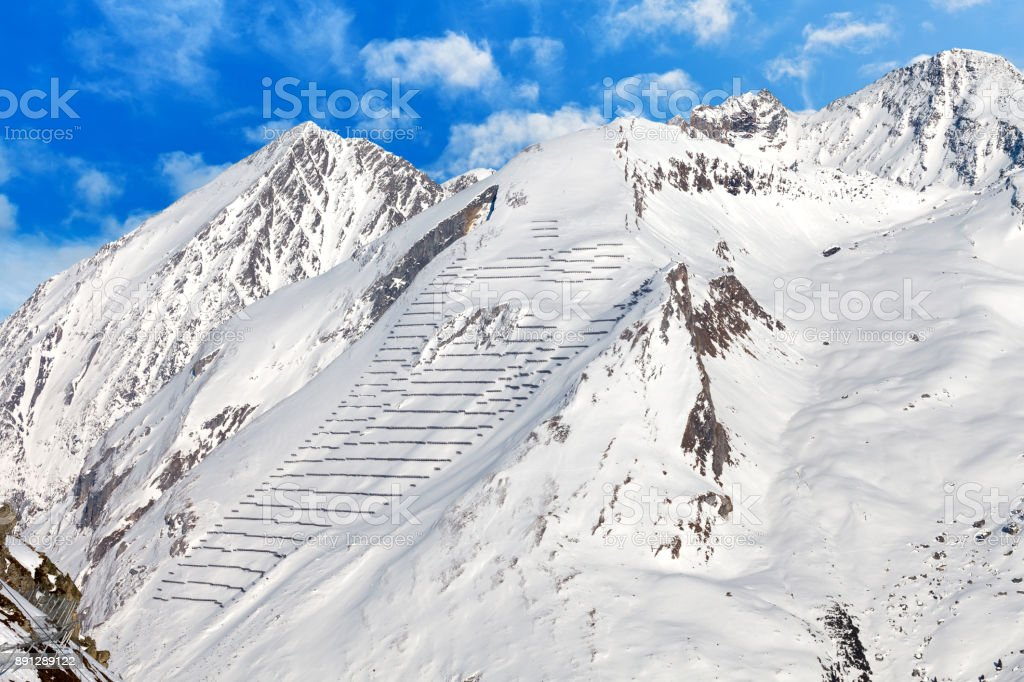 Avalanche protection barriers on mountainside stock photo