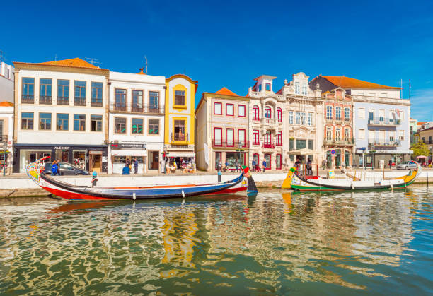 aveiro, portugal: colorful houses and boats in a small town also known as the portuguese venice - aveiro imagens e fotografias de stock