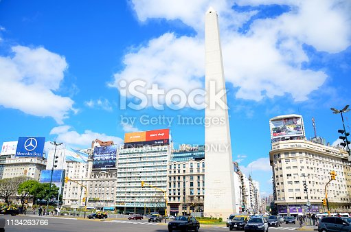Buenos Aires, Argentina - October 26, 2011: Avenida 9 de Julio, in Buenos Aires, is one of the largest avenues in the world. The famous Obelisk is its main attraction.